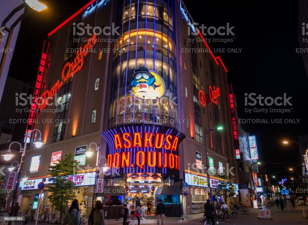 Tourists are shopping in Asakusa Don Quijote Tax free discount store. stock photo