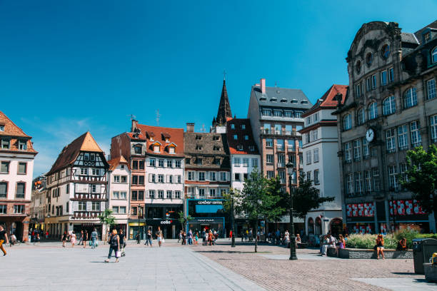 Tourists are sightseeing Place Kleber Strasbourg France Strasbourg, France - 08 21 2013: Tourists are sightseeing Place Kleber Strasbourg France. Strasbourg is the capital and largest city of the Grand Est region of France and is the official seat of the European Parliament. strasbourg stock pictures, royalty-free photos & images
