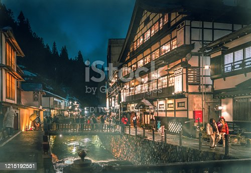 Yamagata; Japan - 27 Dec 2019: Tourists are traveling the Famous Ginzan onsen while snow is falling down.
