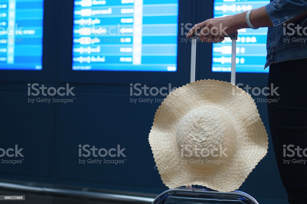 Tourists are viewing the flight schedule. stock photo