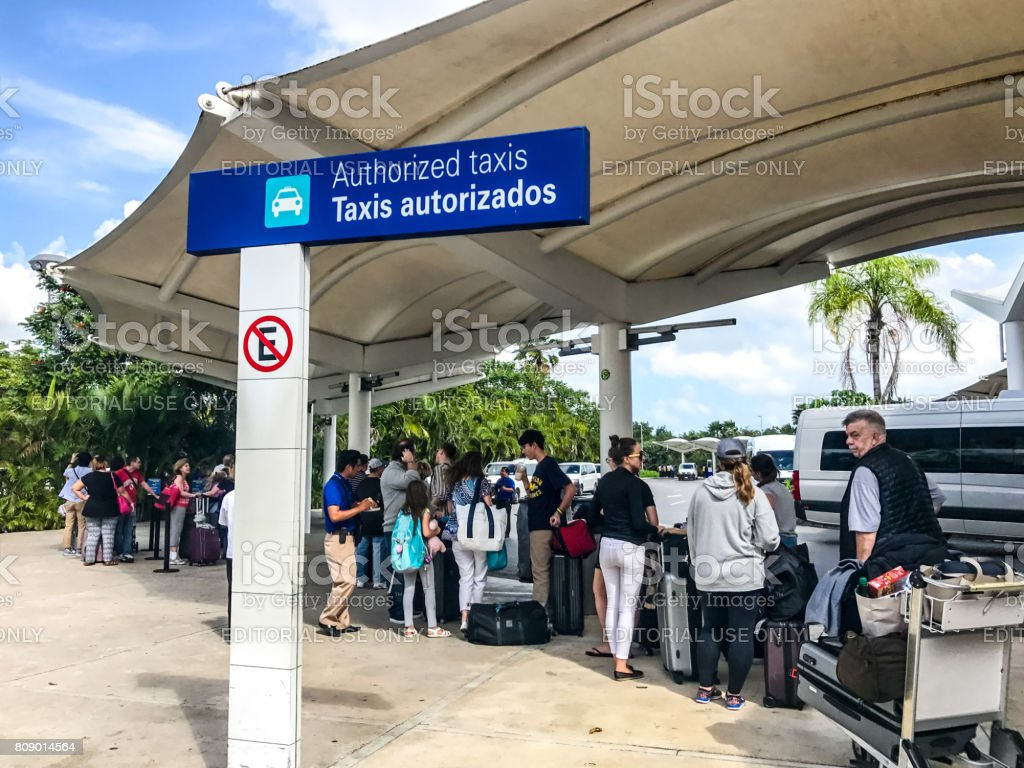 Tourists are waiting in line for taxi in Cancun International Airport, Mexico stock photo