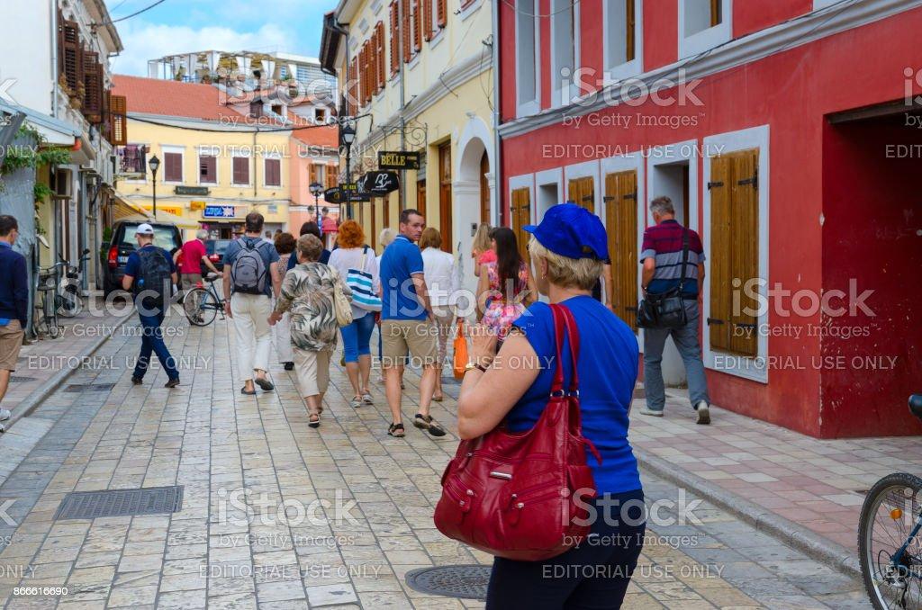 Tourists are walking along street (Rruga G'juhadol) in center of Shkoder, Albania stock photo