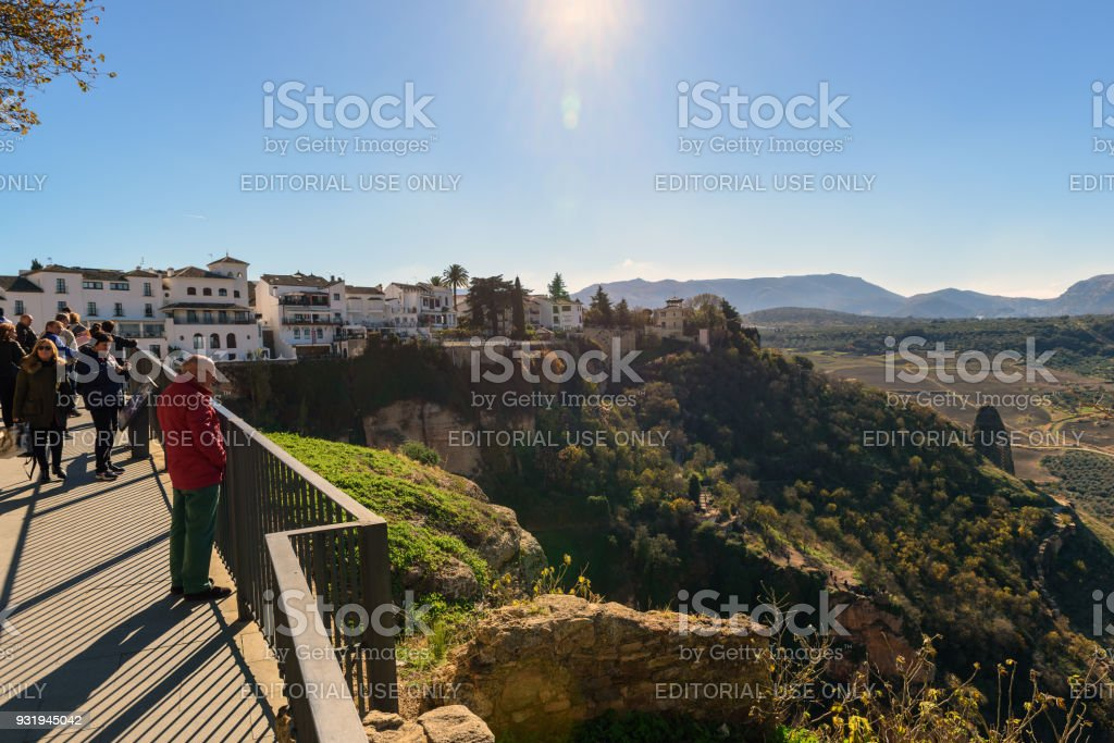 Tourists are walking along traveler path on cliffs around the old town stock photo
