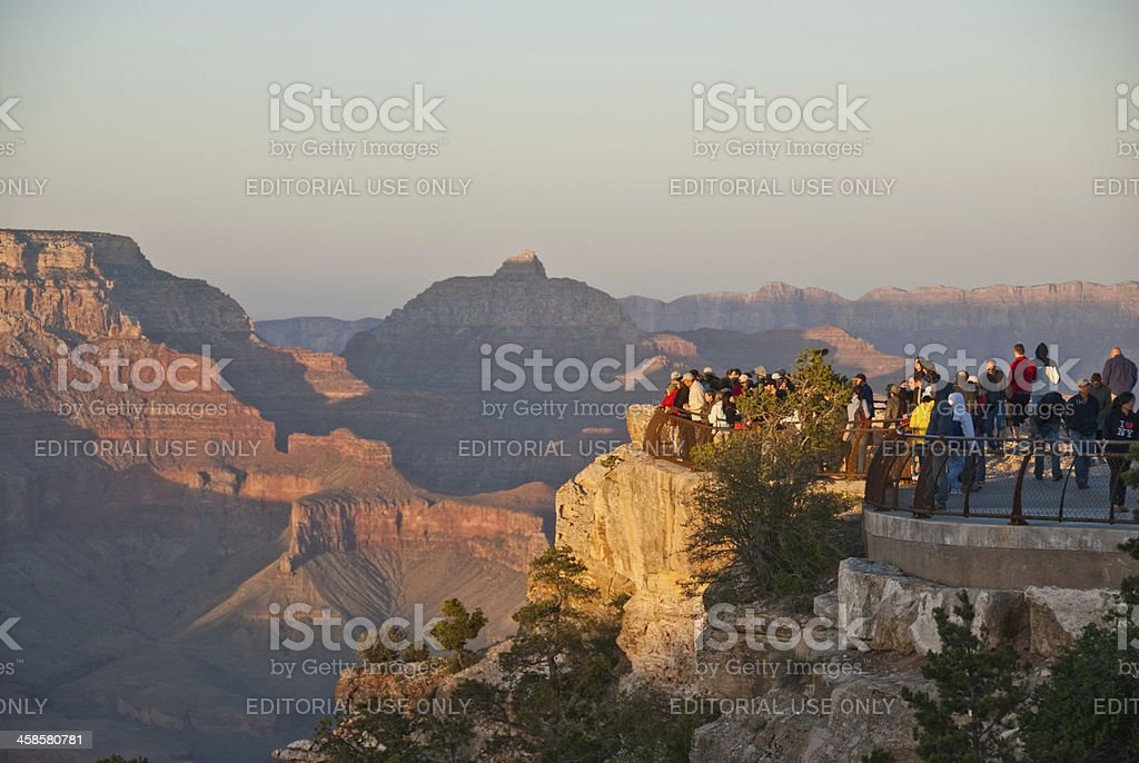 Crowds of Tourists Watch the Sunset from Mather Point stock photo