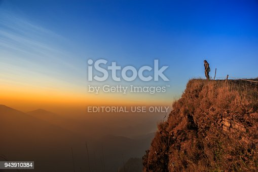 Kanchanaburi, Thailand - February 11, 2018: Tourists are watching the sunrise on the mountain.