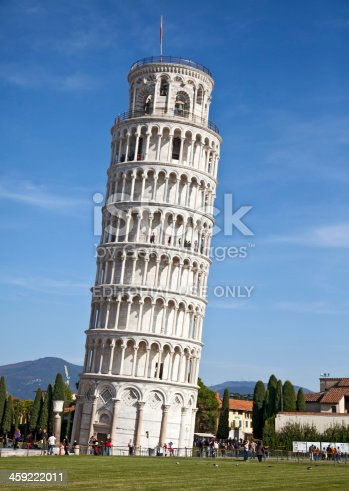 Pisa, Italy - 29th October, 2011: Tourists below and on various levels of the world famous Leaning Tower of Pisa, Tuscany, Italy. The tower was started in 1173, completed in 1372, and after structural restoration completed in 2001, the tower now leans just under 4 degrees.