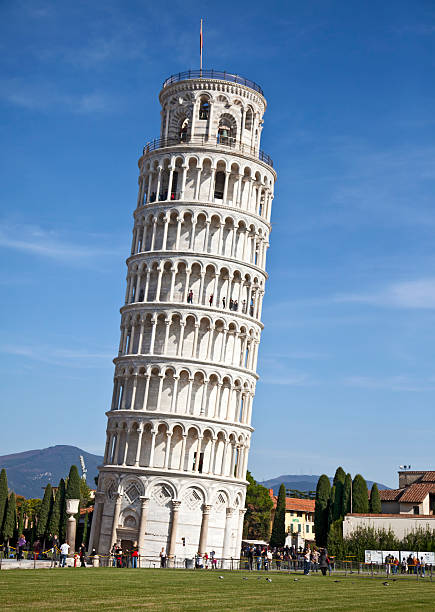 Tourists around the Leaning Tower of Pisa, Italy stock photo