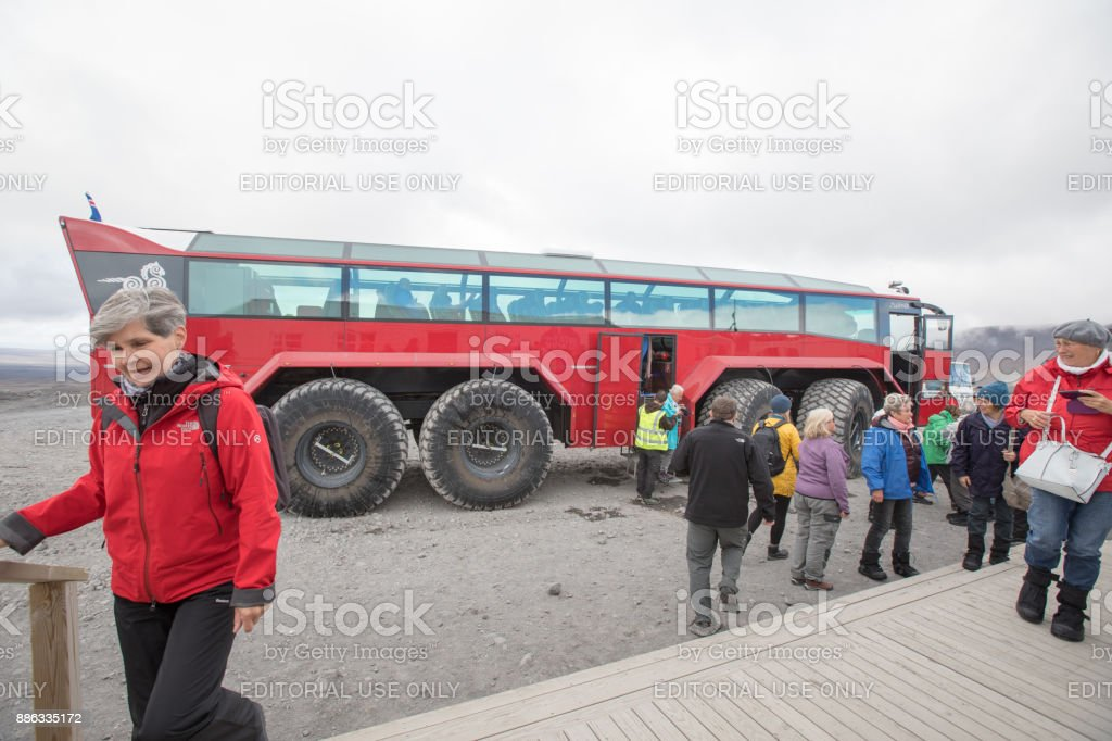 Tourists arrive for tour of  ice caves inside the Langjokull Glacier, Iceland stock photo