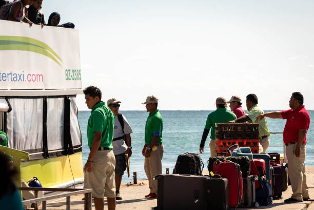 Tourists arrive  to San Pedro, Ambergris Caye from Belize City and greeted by porters in the morning.