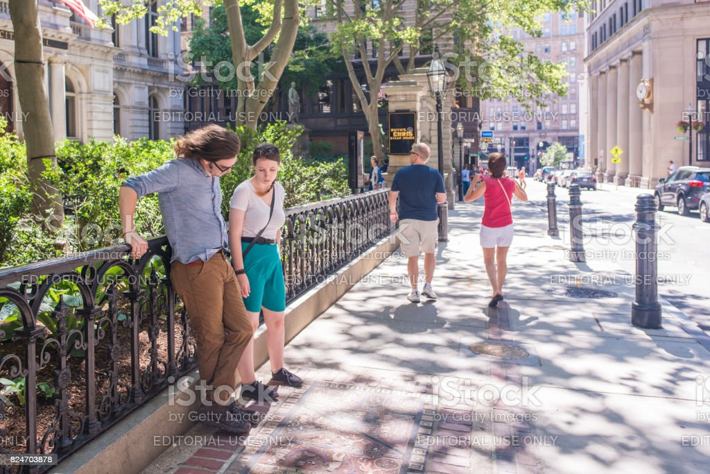 Tourists at a stop along the Freedom Trail in Boston stock photo