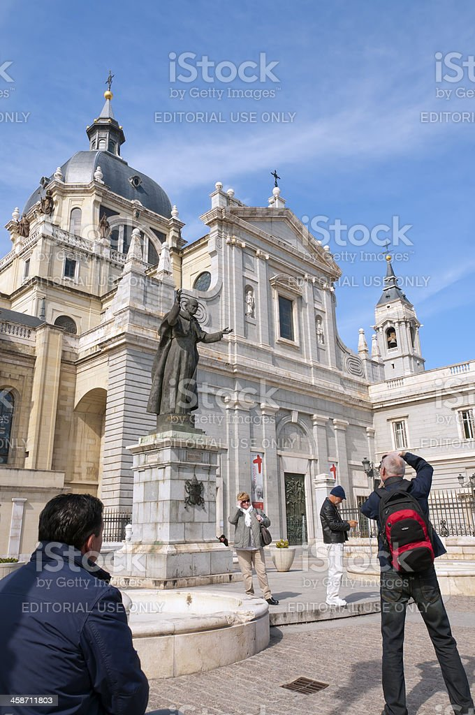 Tourists at Almudena cathedral, Madrid royalty-free stock photo