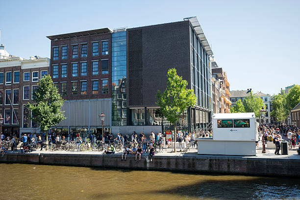 tourists at anne frank house in amsterdam, holland - anne frank haus amsterdam stock-fotos und bilder