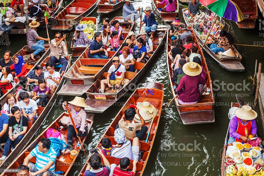 tourists at Damnoen Saduak in Thailand stock photo