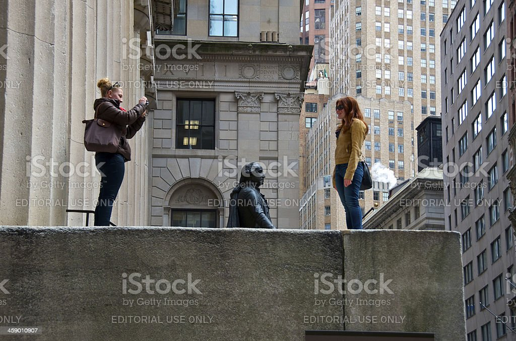 Tourists at Federal Hall, Wall Street, Lower Manhattan, NYC royalty-free stock photo