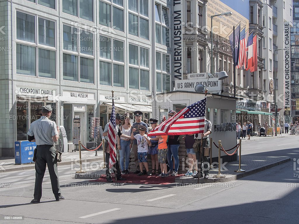 Tourists At Historic US Army Checkpoint Charlie In Berlin, Germany stock photo