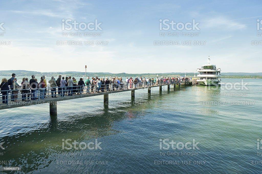 tourists at homeward bound from island Mainau / Germany stock photo