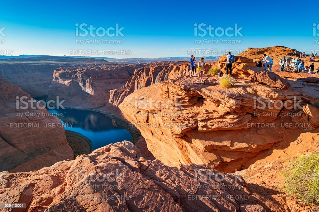 Tourists at Horseshoe Bend near Page Arizona USA stock photo