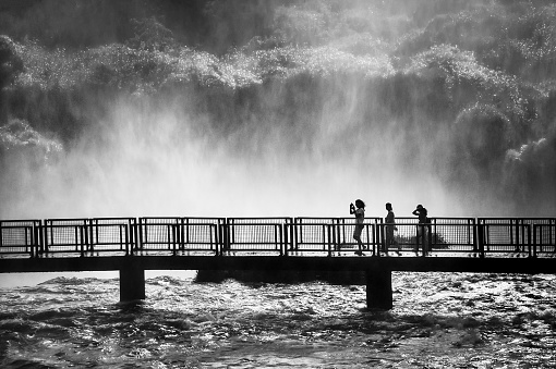 Foz do Iguaçu (Parana), Brazil - January 07, 2009: Tourists are seen in the Iguaçu National Park. Located in Foz do Iguaçu (PR), on the border of Brazil and Argentina, the Iguaçu National Park became the UNESCO World Heritage Site in 1986.