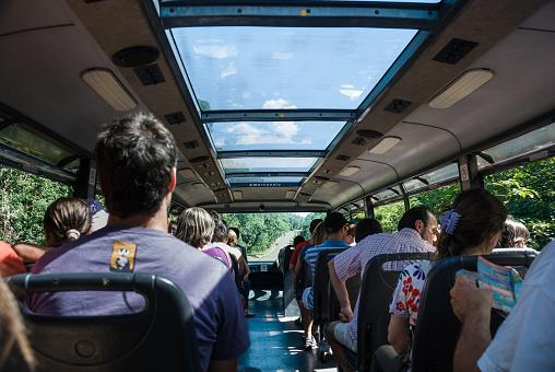 Foz do Iguaçu (Parana), Brazil - January 07, 2009: Tourists are seen at the bus in Iguaçu National Park. Located in Foz do Iguaçu (PR), on the border of Brazil and Argentina, the Iguaçu National Park became the UNESCO World Heritage Site in 1986.