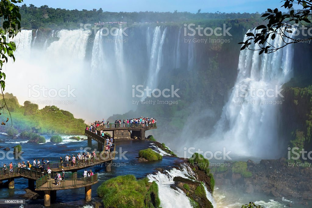 Tourists at Iguazu Falls, Foz do Iguacu, Brazil stock photo