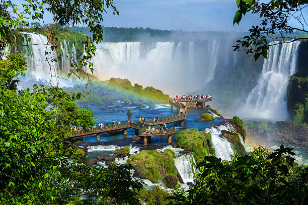 tourists at iguazu falls, foz do iguacu, brazil - south america travel stock photos and pictures
