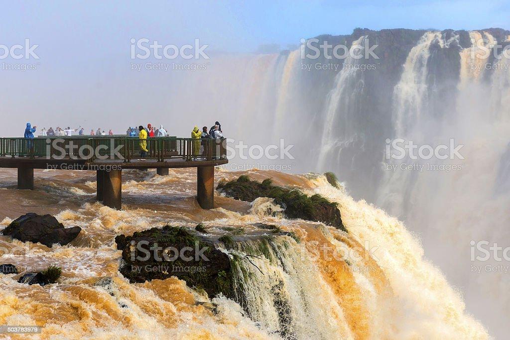 Tourists at Iguazu falls stock photo