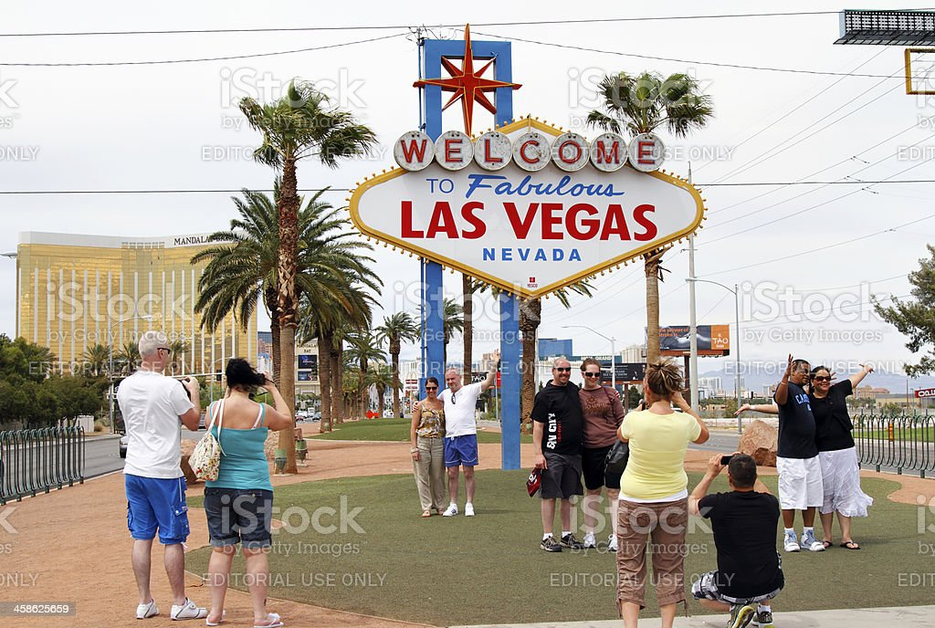 Tourists at Las Vegas sign royalty-free stock photo