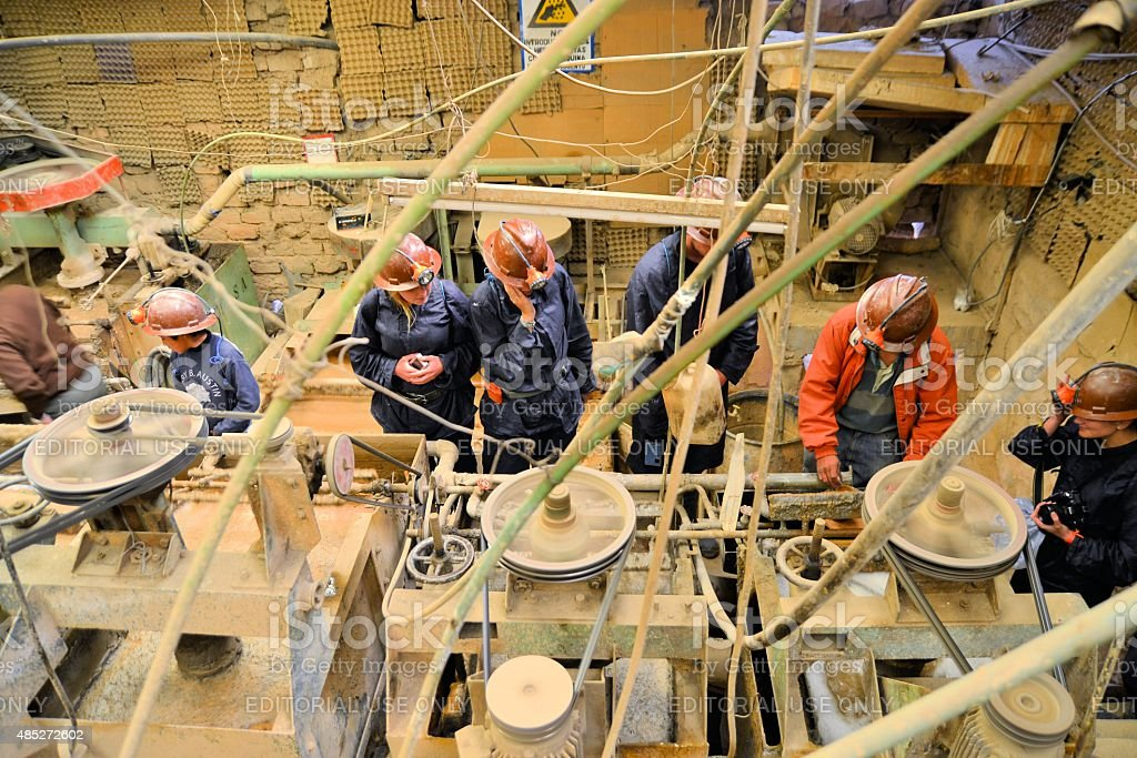 Tourists at Metals and precious metals ore enrichment plant in stock photo