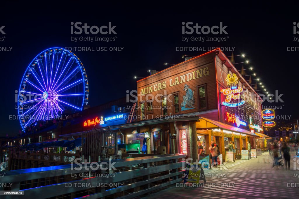 Tourists at Miners Landing in Seattle stock photo