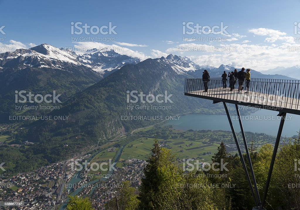 Tourists at mountain viewpoint jetty of Harder Kulm, Interlaken royalty-free stock photo