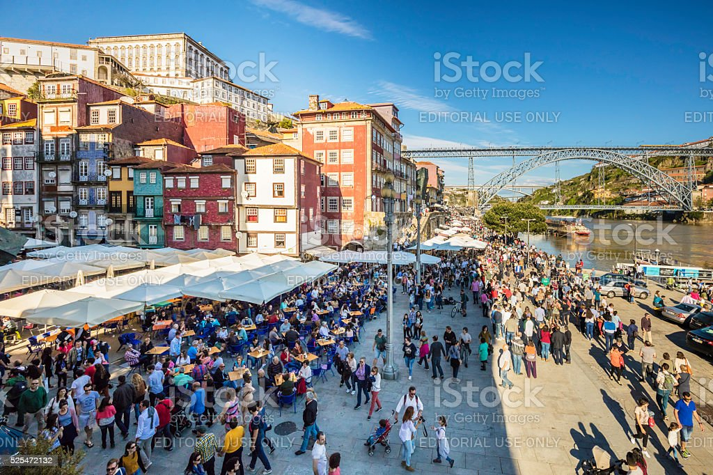 Tourists at River Douro with Dom Luis I bridge stock photo