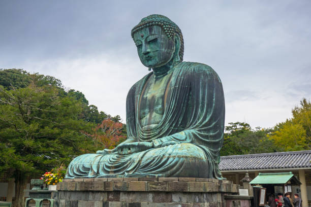Tourists at statue of The Great Buddha of Kamakura, Japan stock photo
