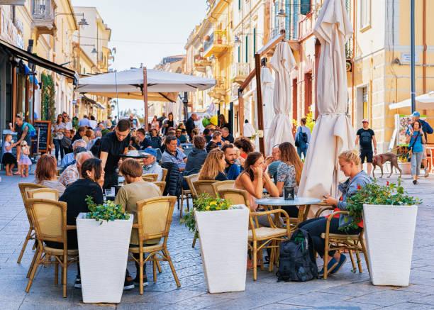 tourists at street cafe on corso umberto street in olbia - sardegna foto e immagini stock