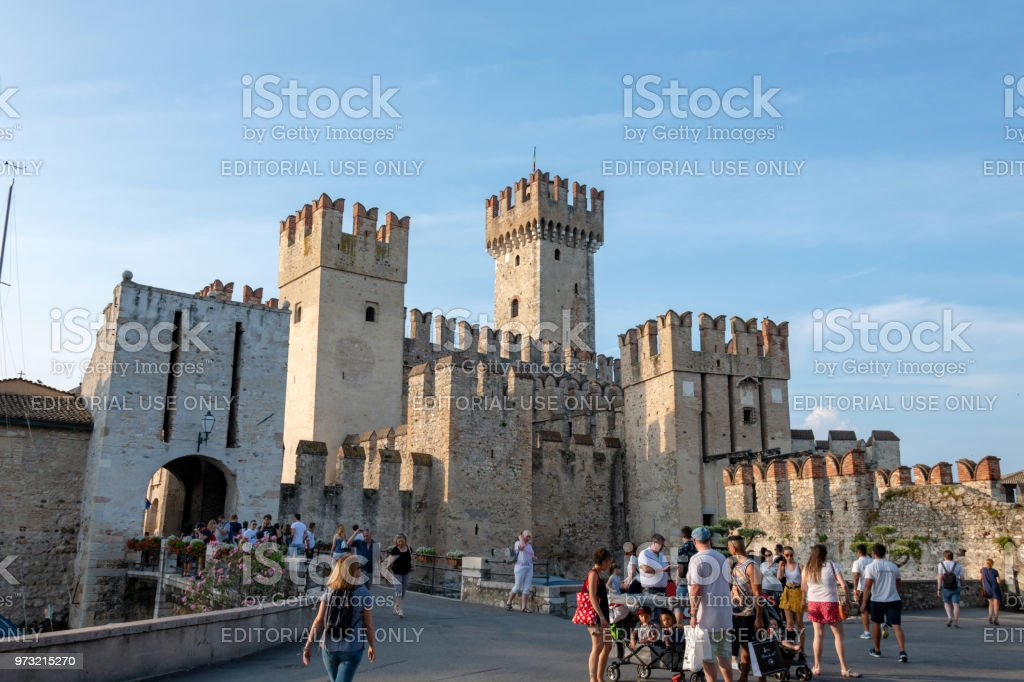 Tourists at the entrance to Sirmione on Lake Garda, Italy stock photo
