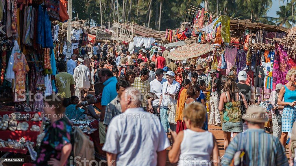 Tourists at the famous flea market in Anjuna, Goa stock photo