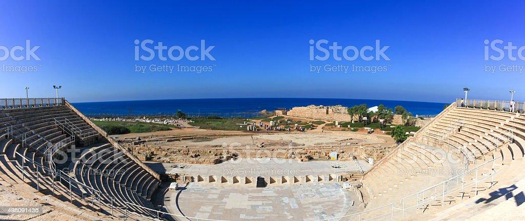 Tourists at the Famous Historical Roman amphitheater at Caesarea stock photo
