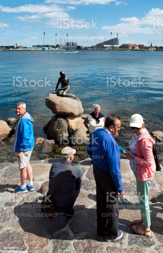 Tourists at the Little Mermaid statue in Copenhagen harbour stock photo