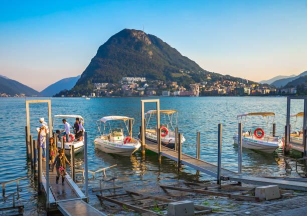 Tourists at the Lugano lake stock photo
