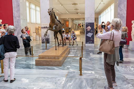 istock Tourists at the National Archaeological Museum in Athens, Greece 1086020384