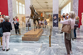 Tourists at the National Archaeological Museum in Athens, Greece