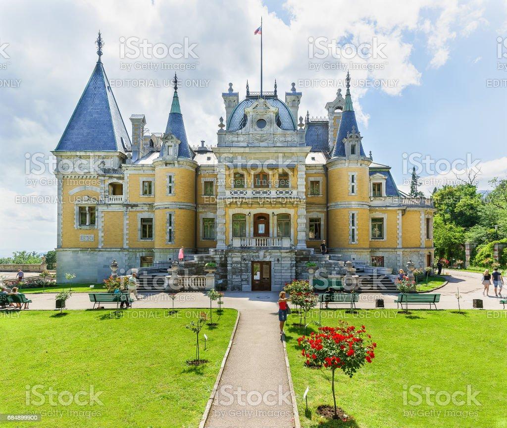 YALTA, CRIMEA, RUSSIA - JUNE 07.2016: Tourists at the Northern facade of Massandra Palace of Emperor Alexander III . stock photo