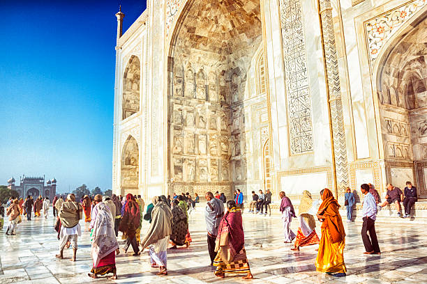 Tourists at the Taj Mahal Tourists visit the Taj Mahal in Agra, India. agra stock pictures, royalty-free photos & images