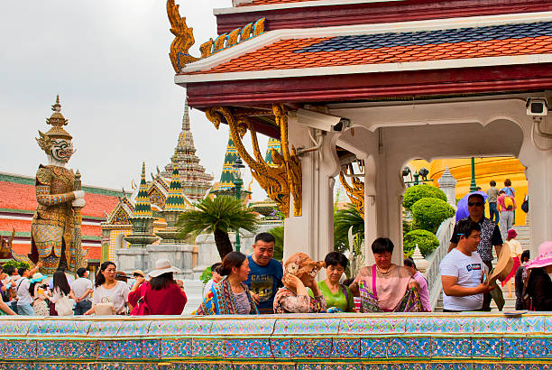 Tourists at the Temple of the Emerald Buddha stock photo