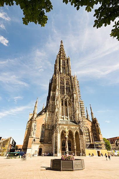 Tourists at the Ulm Minster Ulm, Germany - August 13, 2016: Tourists at the Minster of Ulm, Germany on August 13, 2016. The church has the tallest steeple of the world. Foto taken from Münsterplatz with view to the church. ulm minster stock pictures, royalty-free photos & images