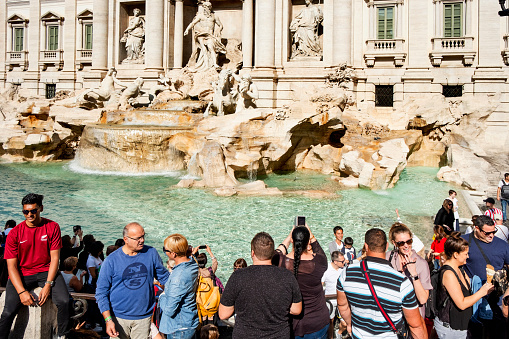 tourists at Trevi Fountain in Rome, Italy