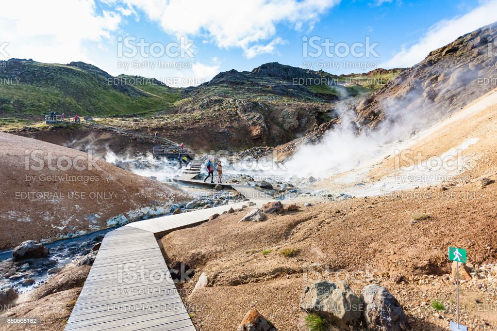 tourists at wooden pathway in Krysuvik , Iceland stock photo