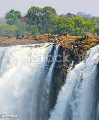 istock Tourists bathing in Devils Pool - Victoria Falls 640202834