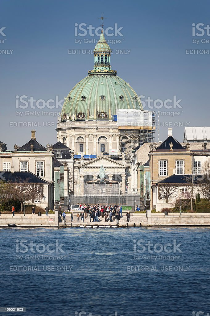 Tourists below the Marble Church and Amalienborg Palace stock photo