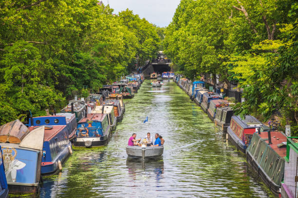 Tourists boating along the Regents Canal around Little Venice in London stock photo