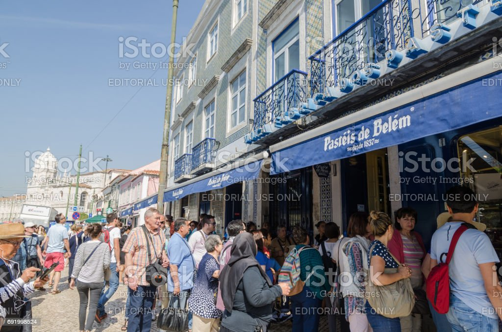 Tourists by a cafe in Lisbon stock photo